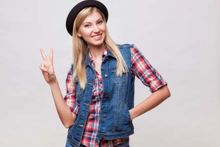 Closeup studio portrait of hipster young woman photo