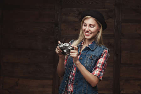 young hipster woman in funky clothes isolated on white background photo