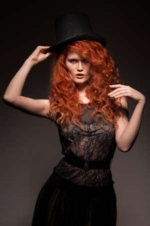 redhead woman wearing black bowler hat