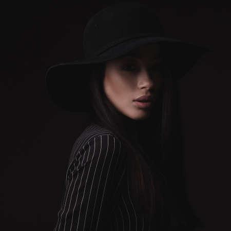 Beautiful woman in retro hat