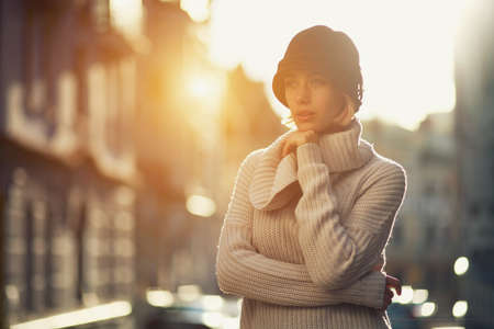 Fashion woman portrait of young girl in a knitted sweater outdoors 스톡 콘텐츠