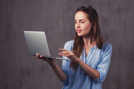 Young beauty brunette woman with laptop 스톡 콘텐츠