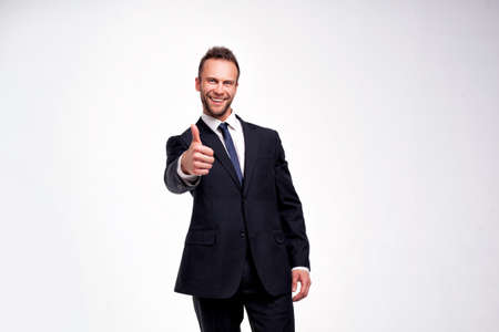 businessman showing thumbs up gesture