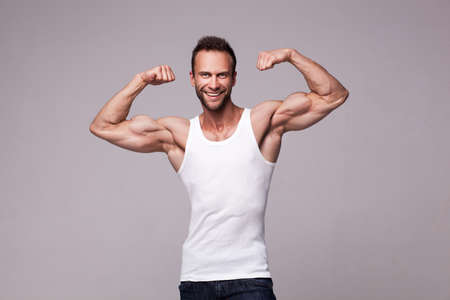 Portrait of athletic man in white undershirt Stock Photo