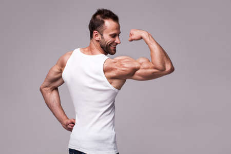 Portrait of athletic man in white undershirt 스톡 콘텐츠