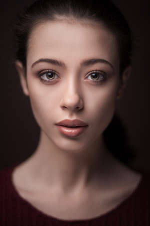young woman with clean skin on black background 스톡 콘텐츠