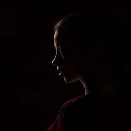 female silhouette isolated on black background 스톡 콘텐츠