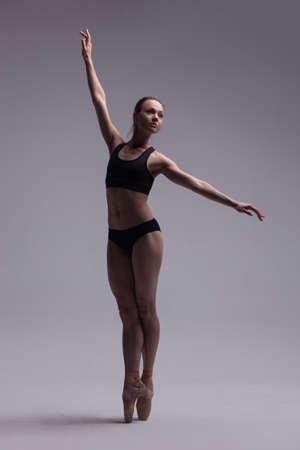 Beautiful Ballet Dancer Posing On Pointes. 스톡 콘텐츠
