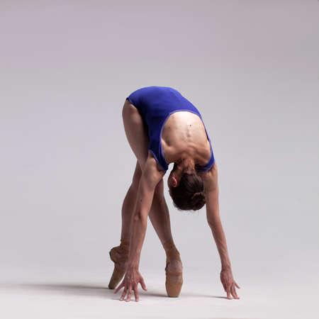 beautiful ballet dancer posing on pointes.
