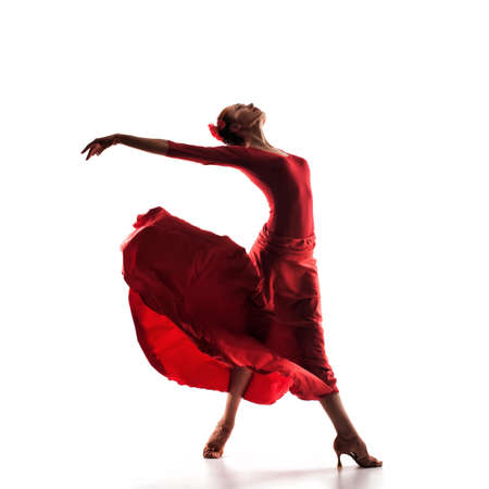 silhouette of woman dancer wearing red dress 스톡 콘텐츠