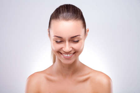 brunette woman with glad smile showing her perfect teeth posing