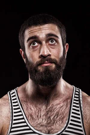 emotional Georgian in a striped shirt 스톡 콘텐츠