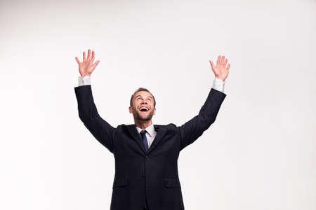 beardy businessman raising his hands up 스톡 콘텐츠