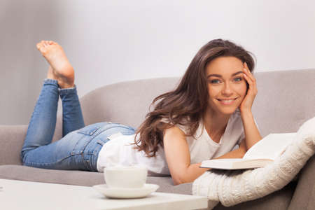 Beautiful young woman reading book 스톡 콘텐츠