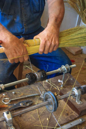A Broom Maker Binding Broom Corn