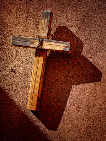 adobe wall: Wooden Cross On Adobe Wall Stock Photo