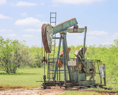 Old Pumpjack On Aging Oil Well