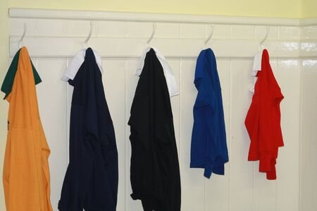 changing room: Shirts on pegs in changing room Stock Photo