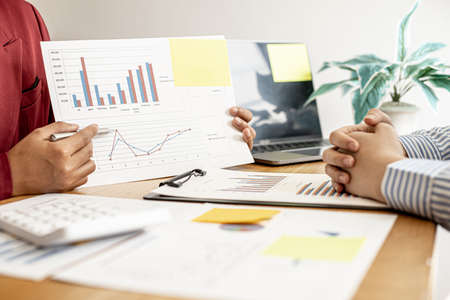 The sales manager is presenting the company's monthly sales data to executives to summarize their performance and jointly plan the sales management. Sales management concept. Stock fotó