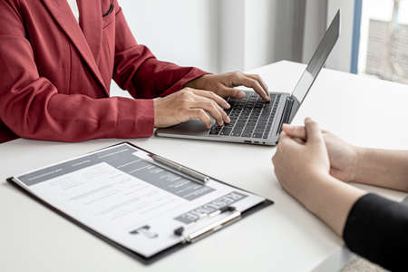The HR department is typing a laptop to fill out the applicant's information after being interviewed by the department manager and accepting jobs for the job applicant. Job application ideas.
