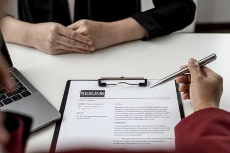 The HR department is reviewing the applicant's resume before giving them an interview with the department manager. The concept of recruiting people to work in the company.