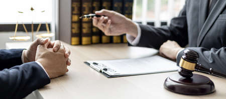 Client was listening to a lawyer advising on an embezzlement case, explaining the details of the proceeding and gathering evidence to file a lawsuit against the defendant. The concept of litigation.