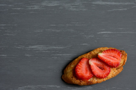 Fresh strawberries on a rustic background