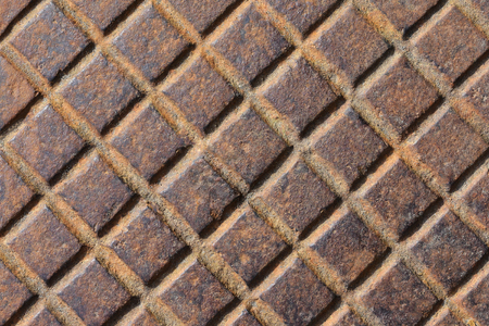 The texture of the hatch. Rusty and red corrugated metal plate. Original background for your text.