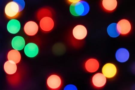 Christmas bokeh in dark background.