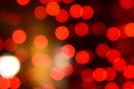 Red christmas bokeh with light beautifully little lights. Blurred background. Place for your text, message or congratulations. Defocused abstract red background. 写真素材