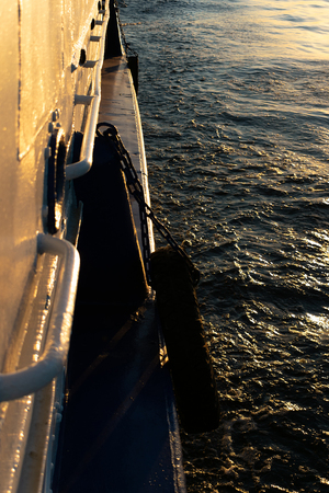 beautiful sunset from the open deck cruise water ship. the concept of travel and relaxing holiday. view of the water in which the sun shines. Stock Photo