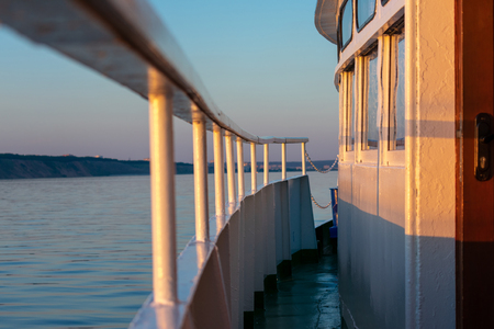 beautiful sunset from the open deck cruise water ship. the concept of travel and relaxing holiday. selective focus.