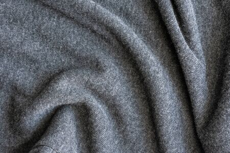 crumpled grey cotton texture. natural fabric background. you can place your text or advertising.