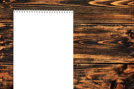 Blank paper on the wooden background, top view, space for text or message. Blank paper mock-up. Banco de Imagens