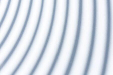abstract striped paper white background. the paper is illuminated through the half-open blinds. shallow depth of field. Banco de Imagens
