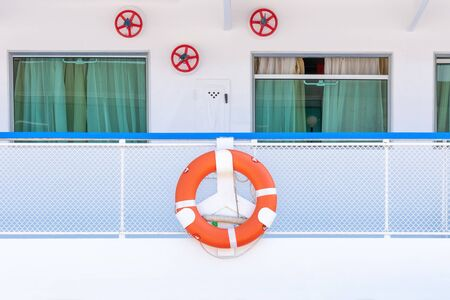 Orange life ring on Board a cruise ship.