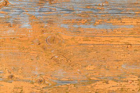 Natural background of aged wood. Orange wood texture.