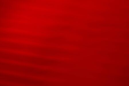Deep red abstract background. Volumetric wavy texture with varying degrees of brightness and illumination. Banco de Imagens