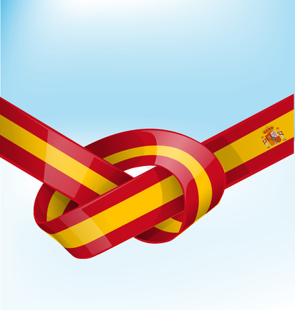 made in spain: spain flag ribbon on bue sky background