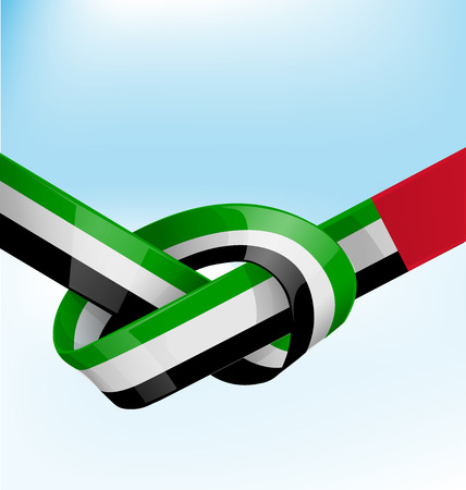 United arab emirates ribbon flag on bue sky background