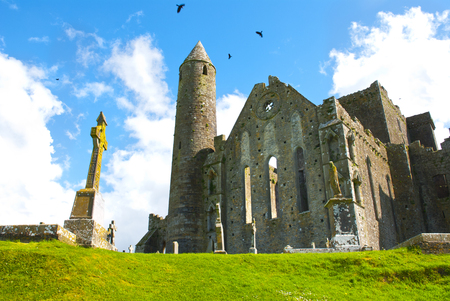 The Rock of Cashel in ireland with cross Фото со стока