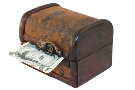 Antique treasure chest with dollar bill isolated on white background photo