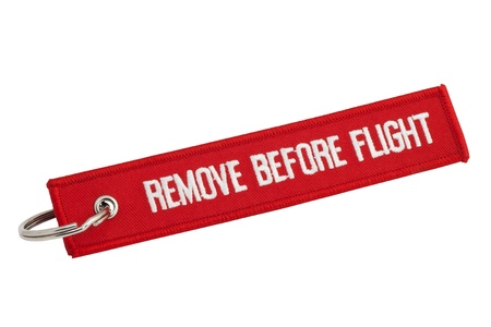 remove: Remove Before Flight Red Tag on White Background