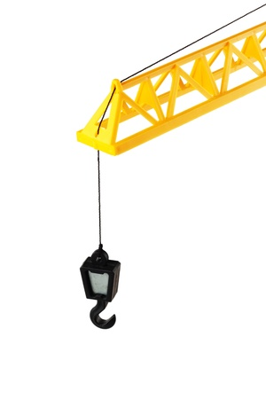 hook up: Yellow Hoisting crane isolated on the white background Stock Photo