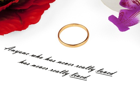 aphorism: Love aphorism with ring on the white background