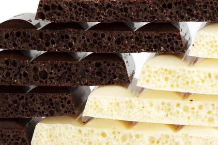 porous: Heap of Porous white and brown chocolate