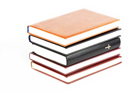 Holy Bible between books on the white background photo