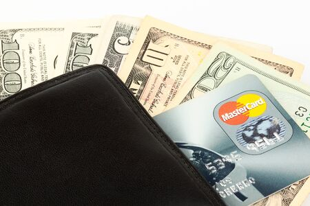 spender: Money and credit card in a wallet on the white Stock Photo