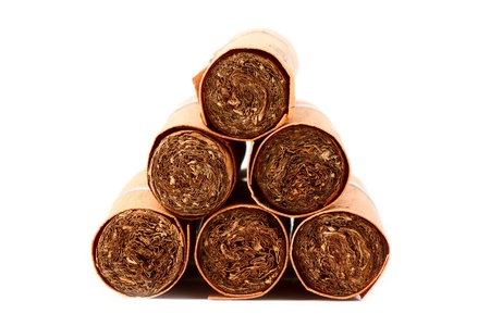 Six Cigars in covers on the white background photo