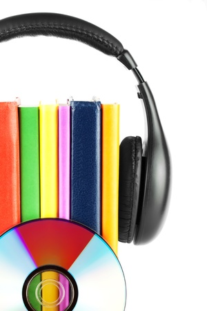 Many books with headphones on the white background photo